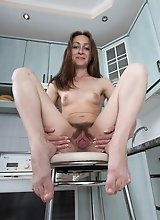 Morana enjoys a sexy striptease in her kitchen